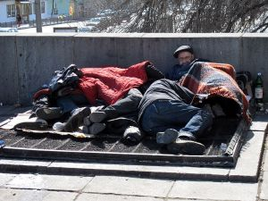 Beggars_rest_near_Russian_State_Library_and_Moscow_Kremlin_(2011-03-29)
