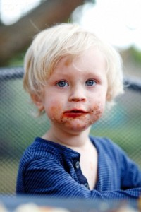 Young boy with his mouth smeared with chocolate