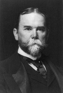 220px-John_Hay,_bw_photo_portrait,_1897