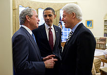 220px-Obama,_Bush,_and_Clinton_discuss_the_2010_Haiti_earthquake