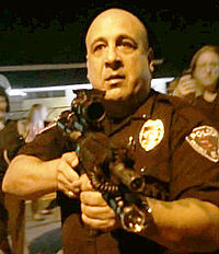 Lt_Ray_Albers_points_rifle_in_Ferguson